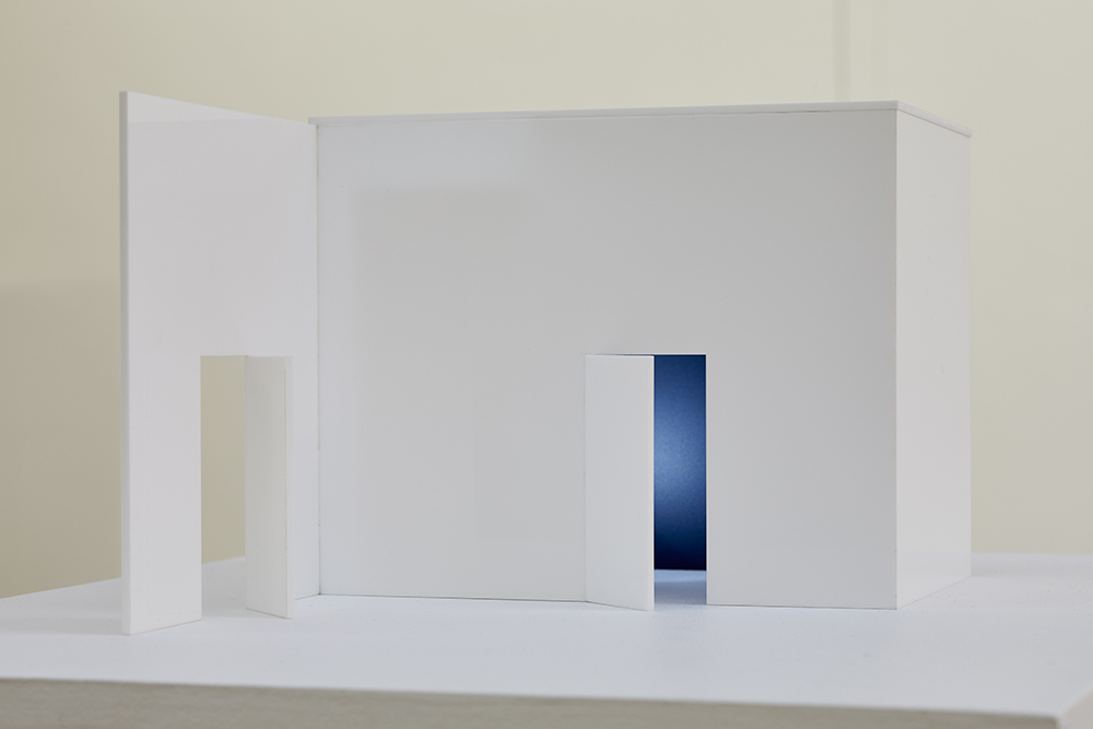 small art object-white perspex structure with lit interior-two doors