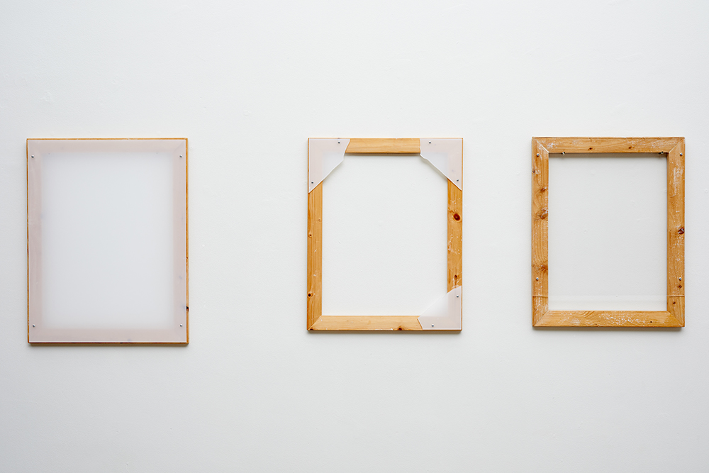 three empty frames-perspex coverings-complete and broken-translucent and clear