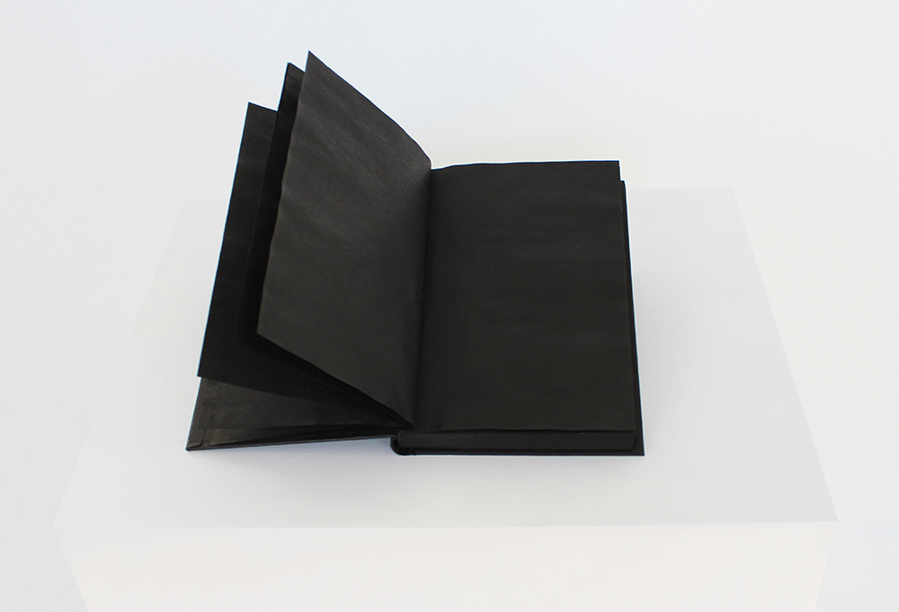 contemporary book art-black ink saturated book-text obliterated to nothingness