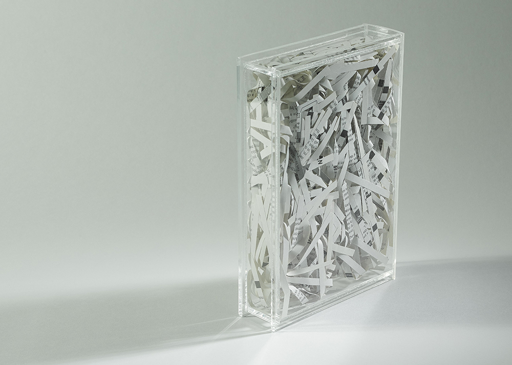 clear perspex book cover-shredded book pages inside