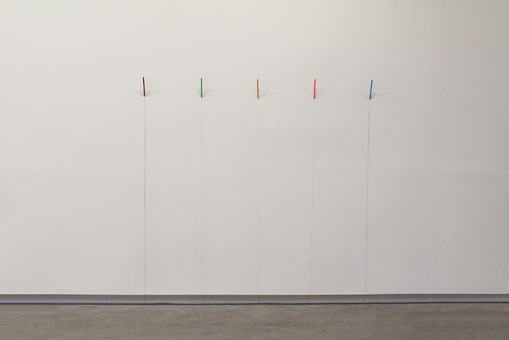 5 coloured pencils-fixed to gallery wall-lines trail on to the floor
