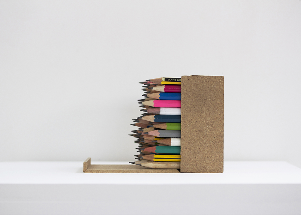 coloured pencil stubs-tightly fitted-box-lying sideways